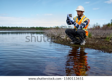 Marine biologist analysing water test results and algea samples Photo stock ©