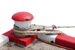 Marine bollard and old rope in pier used for mooring commercial fishing boats and footpath color red and white Is a traffic symbol is that all types of cars are prohibited to stop in this area.
