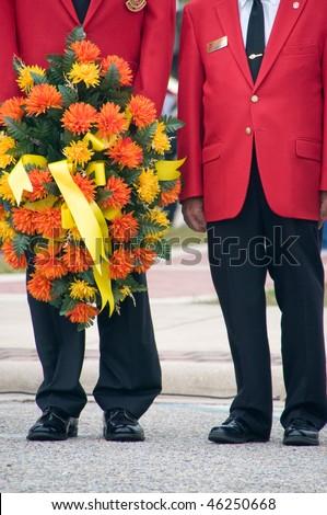 Marine corps war veterans holding ceremonial wreath