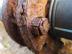 Marine corrosion in the form of general attack on carbon steel flanges or metal equipment on pier. Area most affected is wet and dry zones. Severe corrosion was evidenced by corrosion product layers.