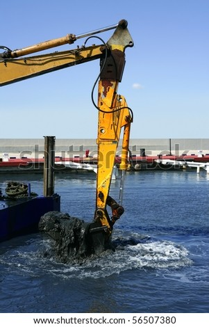 marine dredging digging sea bottom black mud in marina