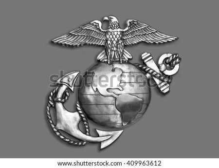 Marine eagle,globe and anchor brass emblem in black and white.