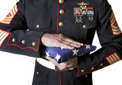 Marine in Dress Blues Holding Flag