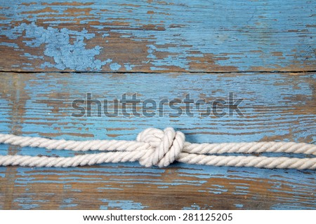 marine knot on blue wooden...