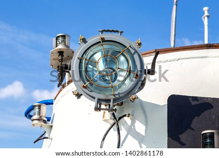 Marine navigation equipment. Glass signal light on the passenger ship #1402861178