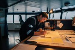 Marine navigational officer during navigational watch on Bridge . He does chart correction of nautical maps and publications. Work at sea