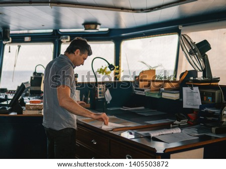 Marine navigational officer or chief mate on navigation watch on ship or vessel #1405503872
