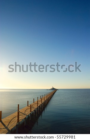 marine pier with yacht moored to