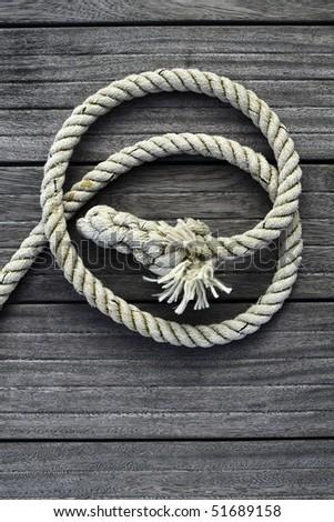 marine rope gray aged teak wood background