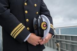 marine sailor holding his hat