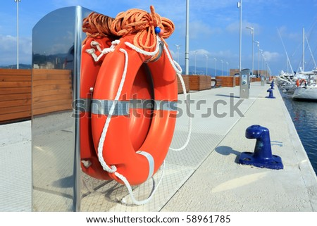marine security concept, red lifebuoy in harbor