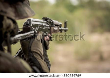 Marine sniper aiming from machine gun during intense training