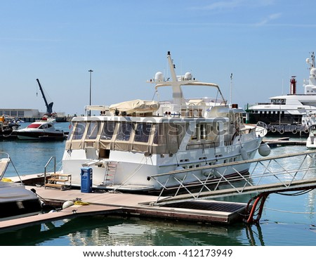 Marine yachts and passenger vessels at berth on the background of the sea passenger port #412173949