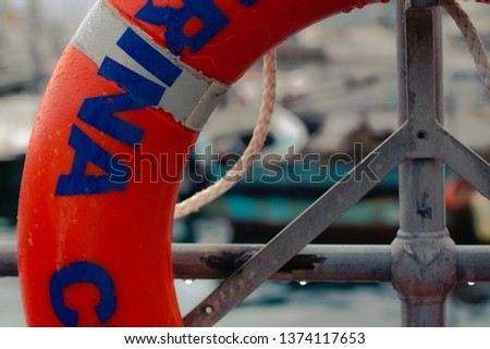 mariner life buoy close up with mariner in background #1374117653