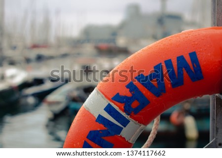 mariner life buoy close up with mariner in background #1374117662