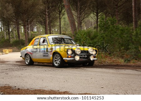 MARINHA GRANDE, PORTUGAL - APRIL 14: Vitor Torres drives a Ford Escort during Rally Vidreiro 2012, integrated on Open Championship in Marinha Grande, Portugal on April 14, 2012.