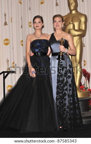 Marion Cotillard (left) & Kate Winslet at the 81st Academy Awards at the Kodak Theatre, Hollywood. February 22, 2009  Los Angeles, CA Picture: Paul Smith / Featureflash