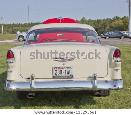 MARION, WI - SEPTEMBER 16: Back of Red & White 1955 Chevy Bel Air car at the 3rd Annual Not Just Another Car Show on September 16, 2012 in Marion, Wisconsin. - stock photo