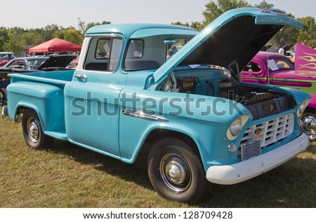 MARION, WI - SEPTEMBER 16: 1955 Chevy Aqua Blue Truck at the 3rd Annual Not Just Another Car Show on September 16, 2012 in Marion, Wisconsin.