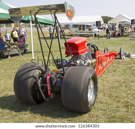 MARION, WI - SEPTEMBER 16: Rear view of a red drag racing car at the 3rd Annual Not Just Another Car Show on September 16, 2012 in Marion, Wisconsin. - stock photo
