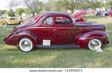 MARION, WI - SEPTEMBER 16: Side of 1940 Ford DeLuxe car at the 3rd Annual Not Just Another Car Show on September 16, 2012 in Marion, Wisconsin. - stock photo