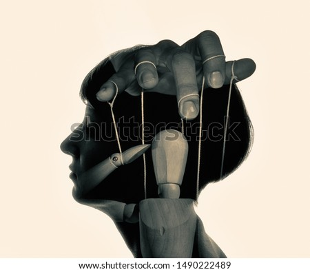 Marionette in woman head, black and white. Concept of mind control. Image Stock photo ©