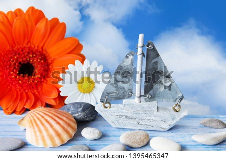 Maritime summertime beach decoration and flowers #1395465347