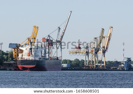 MARITIME TRANSPORT - Freighter at the transhipment terminal in a seaport