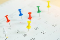 mark the event day with a pin. Thumbtack in calendar concept for busy timeline organize schedule,appointment meeting reminder. planning business meeting or travel holiday planning concept. soft focus