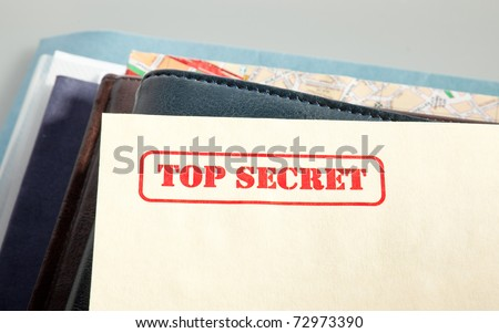 """marked """"top secret"""" on a pile of documents"""