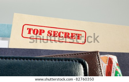 "marked ""top secret"" on a pile of documents"