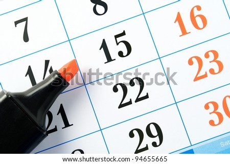 Marker is on page calendar to mark the date