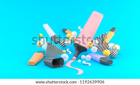 Marker pen among colorful balls on a blue background.-3d rendering.