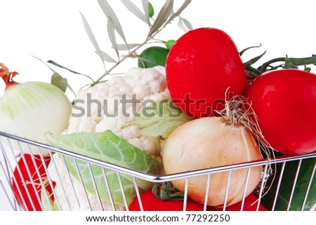 market basket filled with vegetables on white