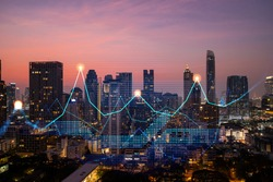 Market behavior graph hologram, sunset panoramic city view of Bangkok, popular location to achieve financial degree in Asia. The concept of financial data analysis. Double exposure.