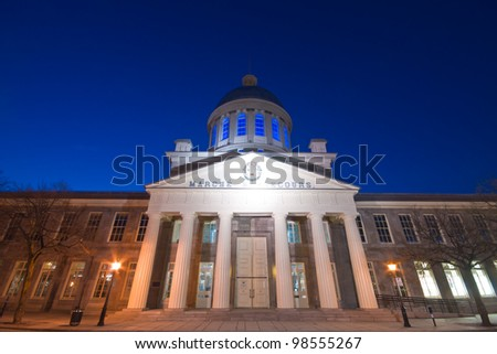 Market Bonsecour facade at dusk, with the dome illuminated in blue.