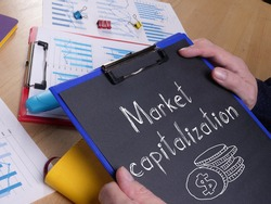 Market capitalization is shown on the business photo using the text