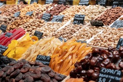 Market counter with various assorted dried fruits and nuts. Healthy food. Local market