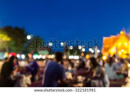 Market fair in abstract blur style. People activity in the fair. It's suitable for background,backdrop,wallpaper and artwork design.  #322181981