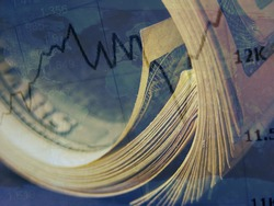 Market graph and rolled dollars. Finance concept.