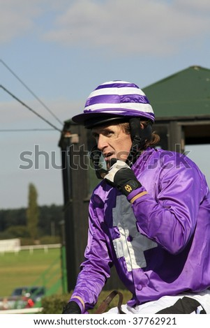 MARKET RASEN, LINCOLNSHIRE - SEPT 26:  Jockey, A P McCoy returns from havine won on Carroll's Cross in the first race at Market Rasen Racecourse, UK  on September 26, 2009 in Market Rasen, Linconshire
