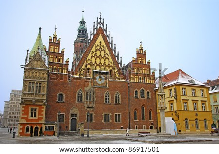 Market square and facade of Town Hall in Wroclaw city, Poland