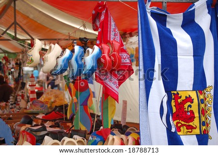 Market stall selling wooden shoes