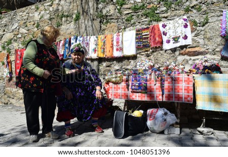 Market street.Market.Bazaar street of the rural Turkish. Local sellers in the Turkish  Bazaar.Comakdaga.Izmir.Turkey.(11.03.18) #1048051396
