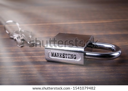 Marketing. Advertising on social networks, campaigns, finance and communication concept. Padlock on wooden table