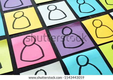 Marketing business segmentation concept. Figurines on the memo sticks.