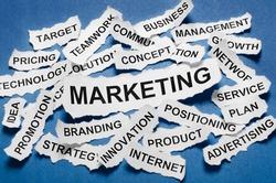 Marketing concept torn newspaper headlines on blue background