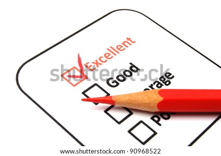 marketing concept with checkbox from questionnaire and red pencil