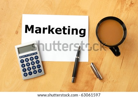 marketing concept with pen paper and cup of coffee