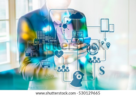 Marketing Data management platform concept image. Data collection icons with Big data analytic message on Double exposure of business man using smart phone, bokeh light.